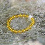 s6355 s3 10464 chuoi ho phach hat vang trong 150x150 Chuỗi Hổ Phách hạt vàng trong A++ 20 hạt S6355 10464